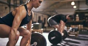 Women is doing a prober deadlift technique to prevent lower back pain